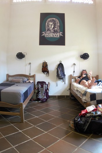 Minca Finca Hostal Bolivar Dorm beds withposter